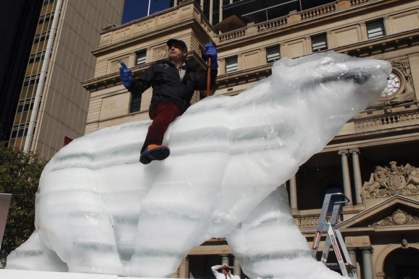 Coreth rides his life size ice polar bear in Circular Quay in central Sydney