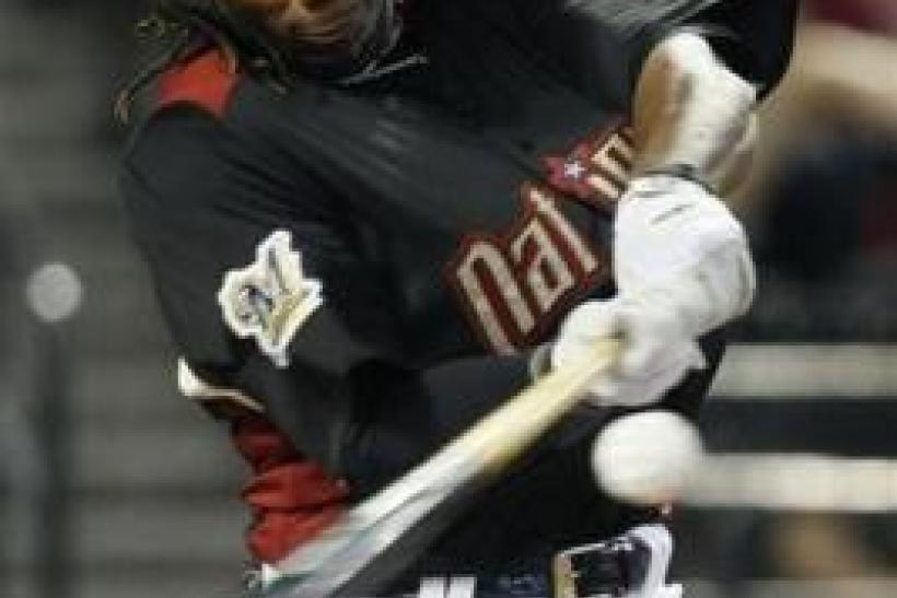 Rickie Weeks of the Milwaukee Brewers hits during the first round of the baseball All-Star Game Home Run Derby in Phoenix, Arizona, July 11, 2011.