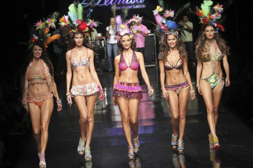 Models present creations by Colombian brand Leonisa during the Colombiamoda fashion show in Medellin