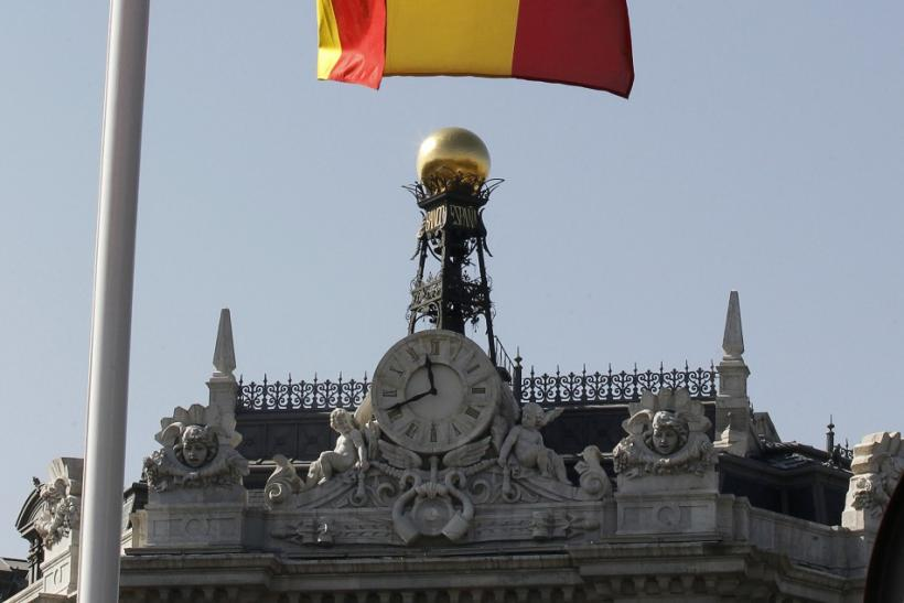 A Spanish flag flutters over the Bank of Spain in Madrid