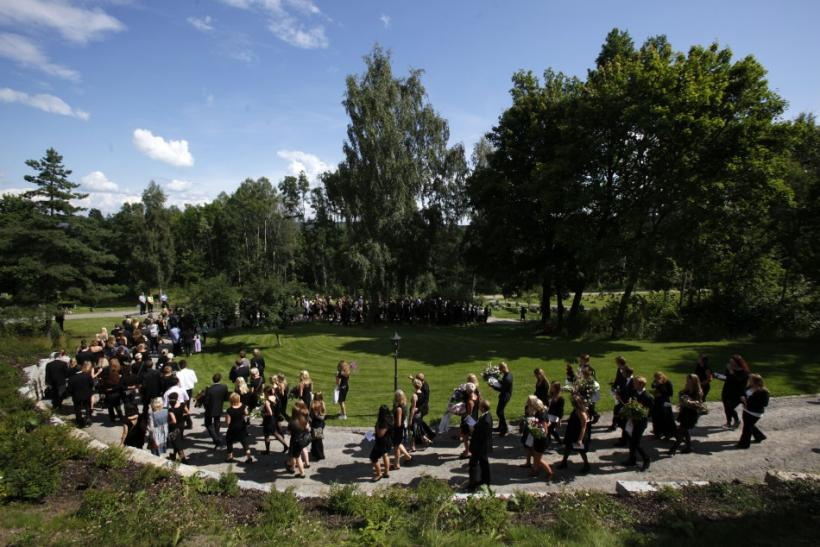 People follow the casket of Rashid which is carried to Nesodden cemetery during the funeral ceremony near Oslo