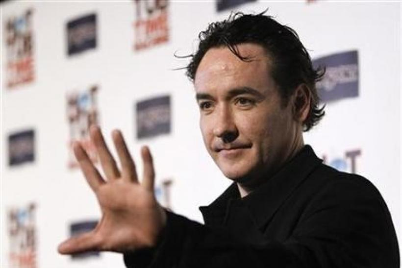 John Cusack waves at the premiere of ''Hot Tub Time Machine'' in Hollywood, California