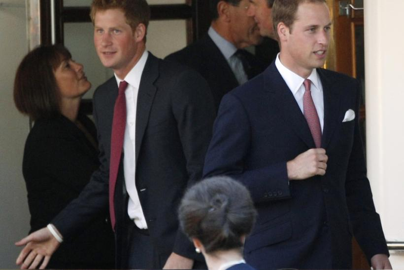 Britain's Prince Harry (L) and Prince William leave a drinks reception on the royal yacht Brittania in Edinburgh, Scotland