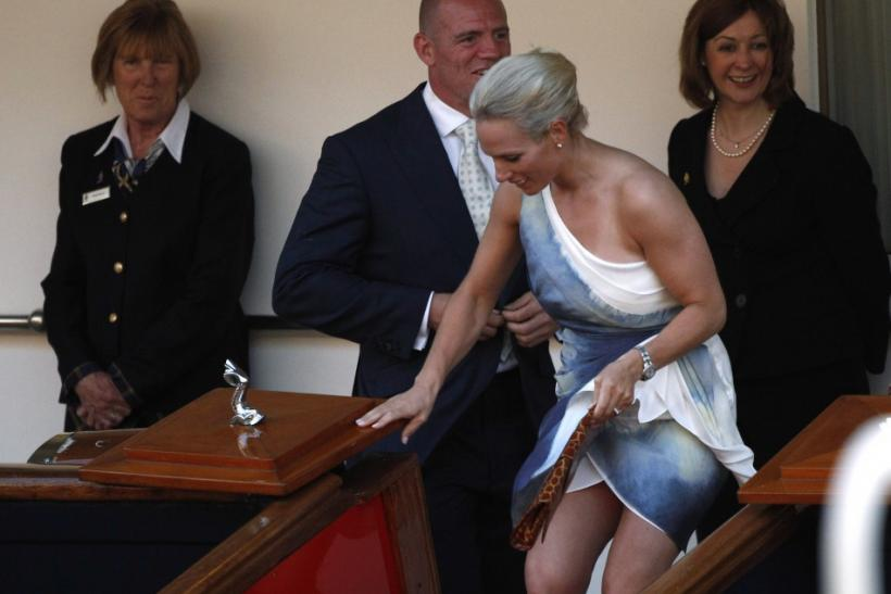 Britain's Zara Phillips, the eldest granddaughter of Queen Elizabeth, and England rugby captain Mike Tindall are seen leaving the drinks reception onboard the Royal Yacht Britannia on the eve of their wedding at Canongate Kirk, in Edinburgh, Scotland