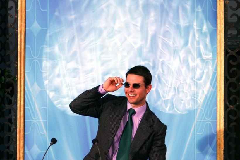 Actor Tom Cruise takes off his sunglasses before giving a speech at the inauguration of of a Scientology church in Madrid