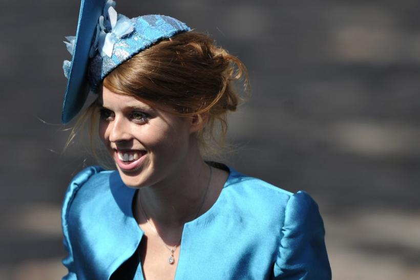 Britain's Princess Beatrice arrives before the marriage of Zara Phillips, the eldest granddaughter of Queen Elizabeth, and England rugby captain Mike Tindall, at Canongate Kirk in Edinburgh, Scotland, July 30, 2011.