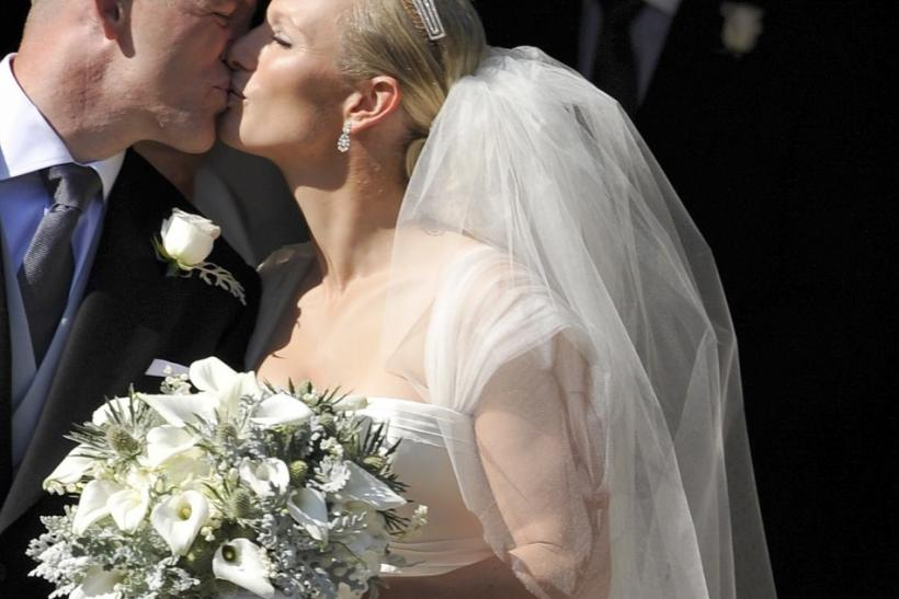 Britain's Zara Phillips kisses her husband Mike Tindall after their marriage at Canongate Kirk in Edinburgh