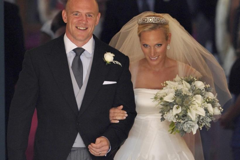 Britain's Zara Phillips and her husband Mike Tindall leave after their marriage at Canongate Kirk in Edinburgh