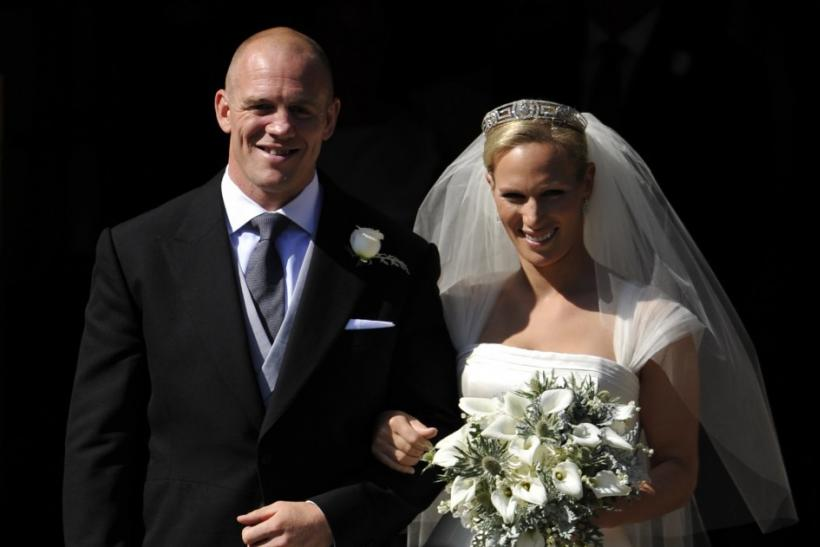 Britain's Zara Phillips poses for a photograph with her husband Mike Tindall after their marriage at Canongate Kirk in Edinburgh