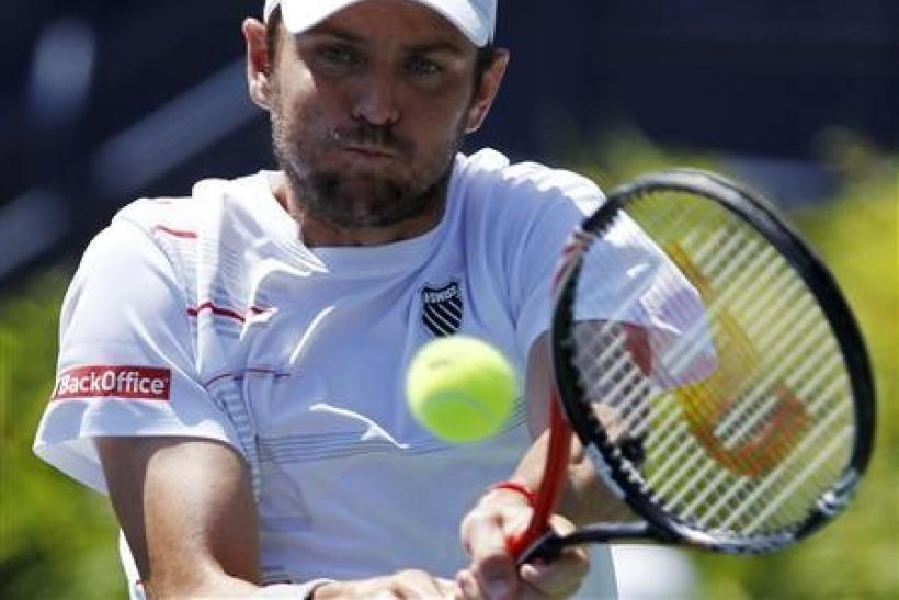 Mardy Fish of the U.S. hits a backhand to compatriot Ryan Harrison during the semi-finals of the ATP Los Angeles International tennis open tournament in Los Angeles, California