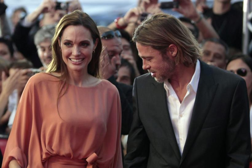 Angelina Jolie and Brad Pitt arrive on the red carpet on the final night of the 17th Sarajevo Film Festival