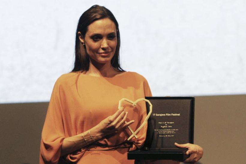 Angelina Jolie poses with Heart of Sarajevo award which she received during 17th Sarajevo film festival in Sarajevo