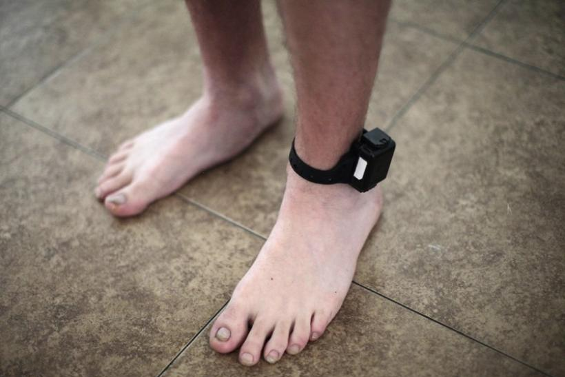 A probationer wears an ankle tracking device in Santa Ana, California