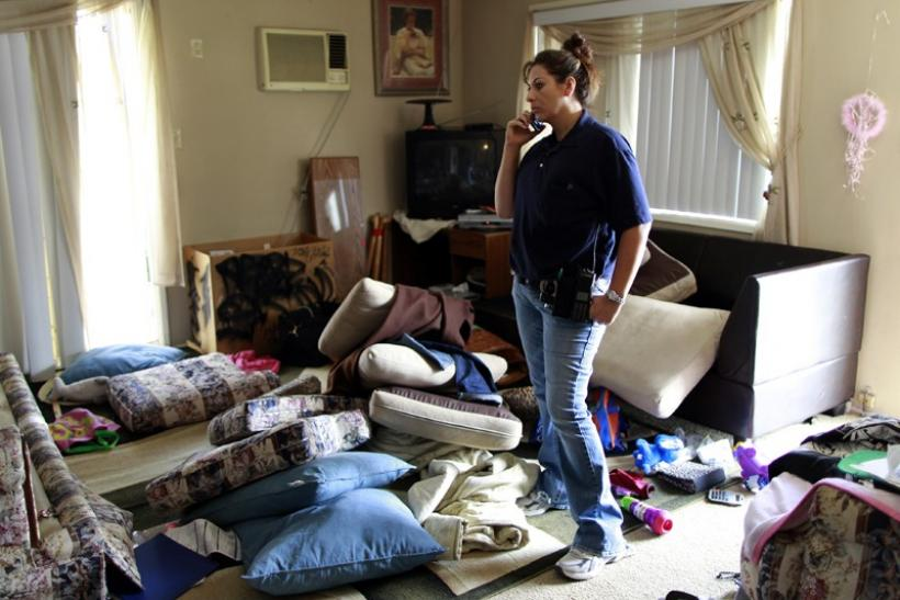 Orange County Deputy Probation Officer Erin Merritt searches a probationer's apartment in Orange, California