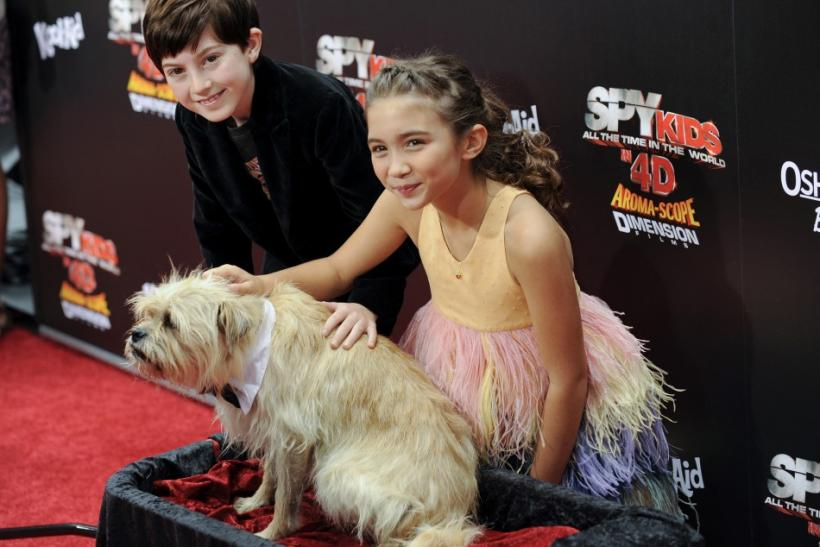 """Actors Mason Cook (L), Rowan Blanchard (R) and dog Smurf from the movie arrive at the """"Spy Kids: All the Time in the World in 4D"""" premiere in Los Angeles, California"""