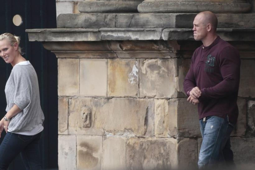 Britain's Zara Phillips, the eldest granddaughter of Queen Elizabeth, and her husband England rugby captain Mike Tindall, leave Holyrood Palace, after their marriage on Saturday, in Edinburgh, Scotland