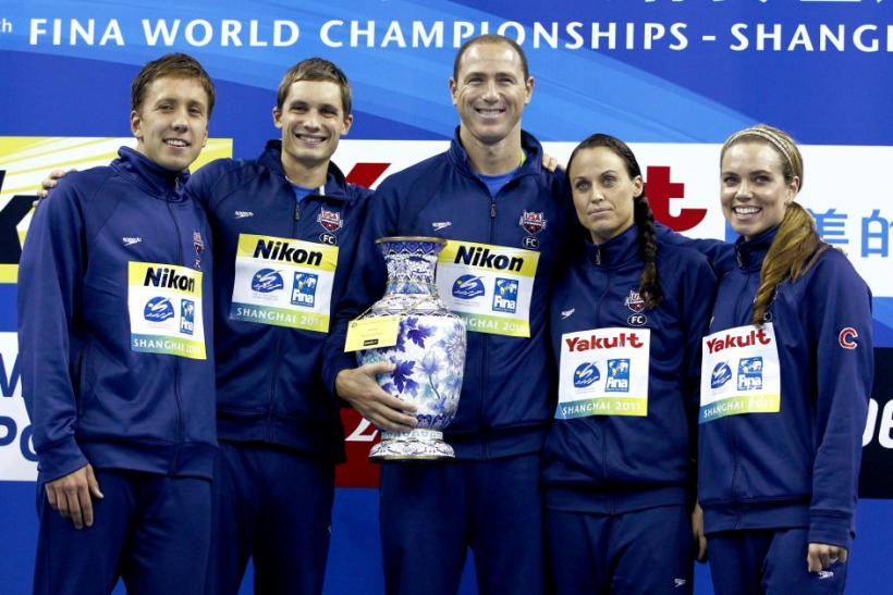U.S. team captain Lezak holds FINA Trophy for the best team at 14th FINA World Championships in Shanghai