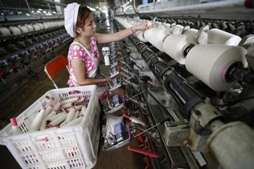 An employee works inside the workshop of a textile factory in Huaibei
