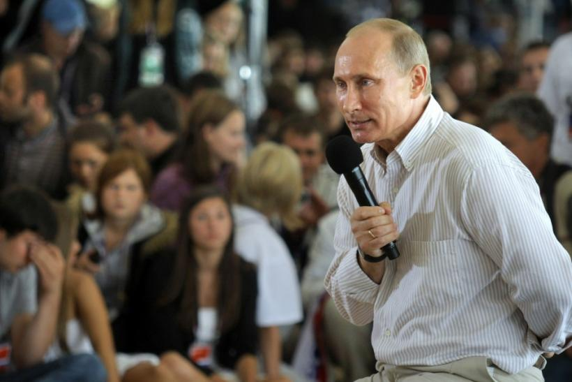"Russian Prime Minister Putin answers questions from the audience during his visit to the summer camp of the pro-Kremlin youth group ""Nashi"" at lake Seliger"