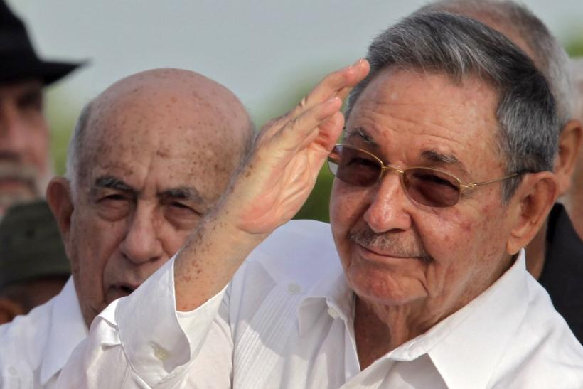 uba's President Raul Castro waves to the crowd next to vice president Jose Ramon Machado Ventura