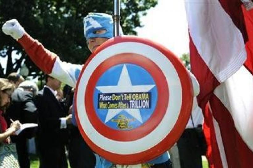 A man dressed as Captain America​ poses as dozens of Tea Party supporters rally