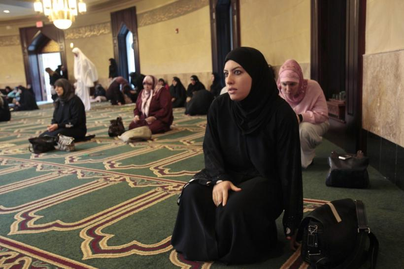 Lamis Ali, 29, arrives for afternoon prayers at the Islamic Center of America in Dearborn