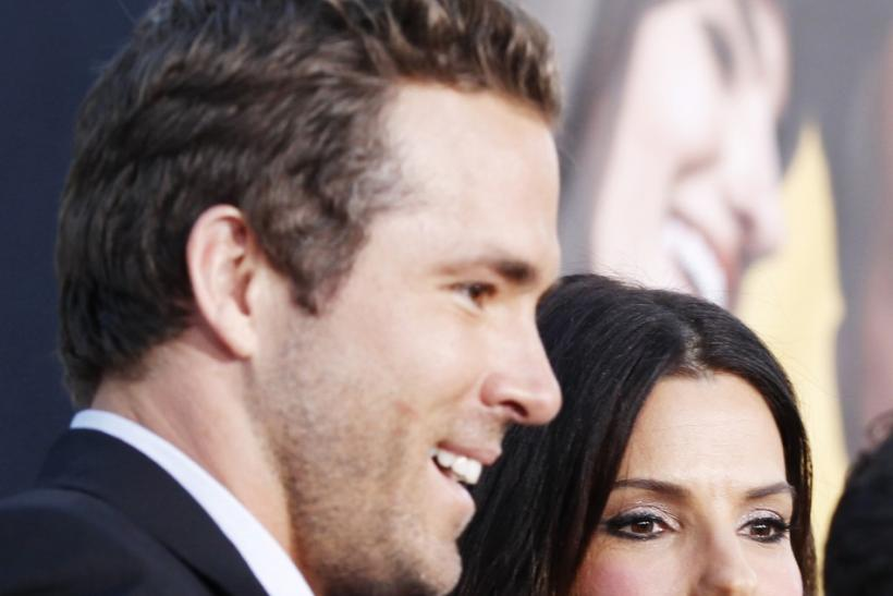 "Sandra Bullock (R) stands with cast member Ryan Reynolds (L) at the world premiere of the film ""The Change-Up"" in Los Angeles"