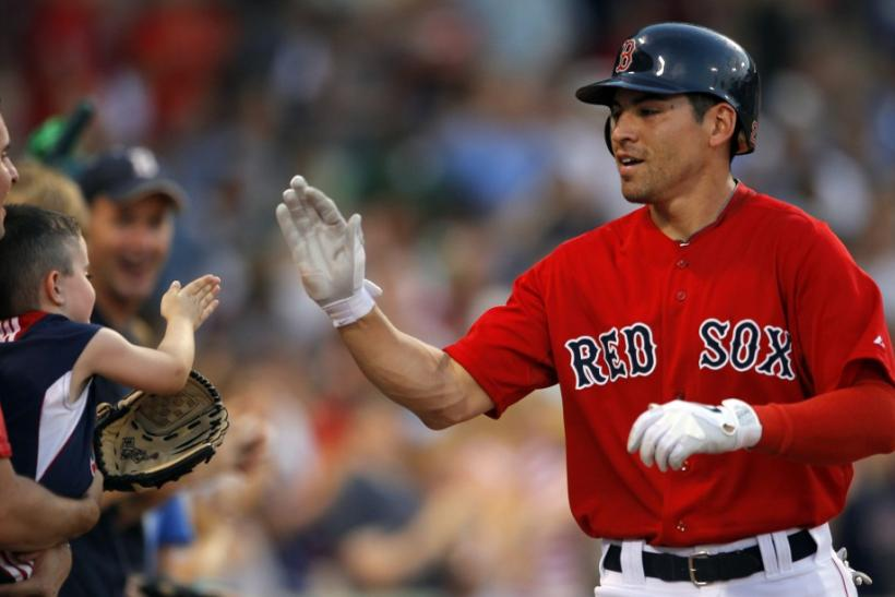 Boston Red Sox Ellsbury high fives a young fan after hitting a home run against the Seattle Mariners in their MLB game in Boston