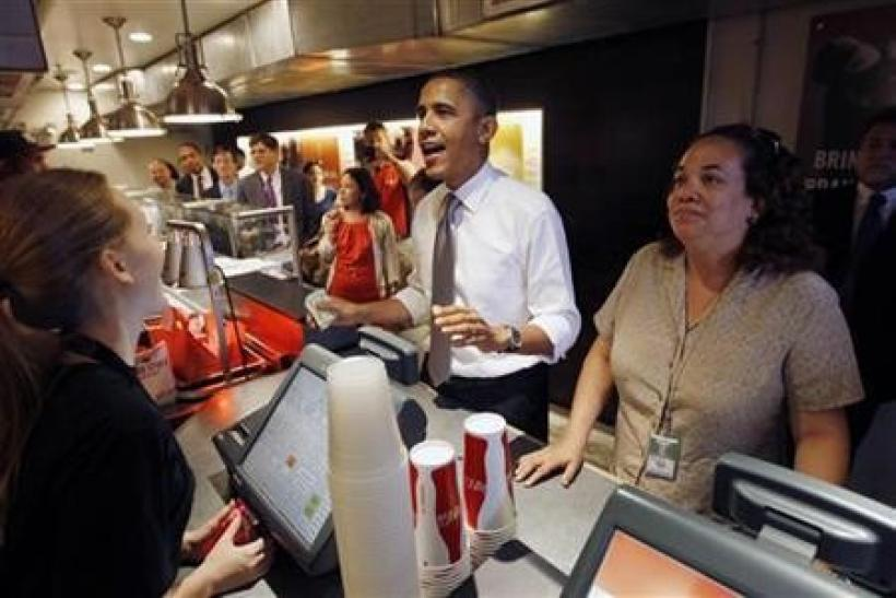 U.S. President Barack Obama orders an hamburger and fries at the Good Stuff Eatery on Capitol Hill in Washington, August 3, 2011.