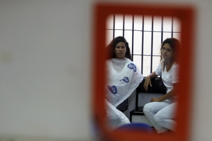 Inmates of the Women's Prison of Brasilia prepare for the third annual beauty pageant titled Miss Penitentiary, in Brasilia August 3, 2011. A modelling agency selected 12 finalists out of the nearly 100 women who entered the competition.