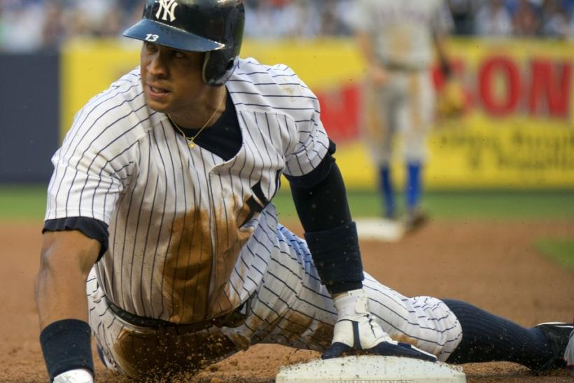 New York Yankees Alex Rodriguez steals third base against Texas Rangers in New York
