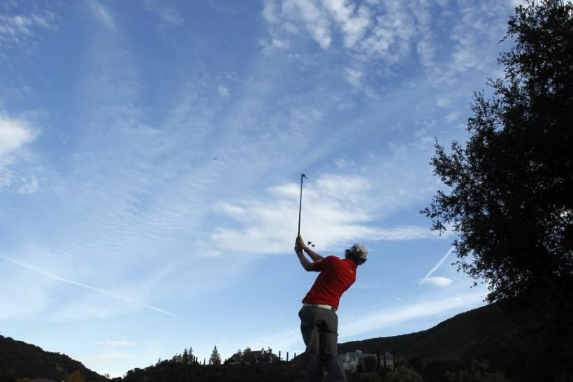 Mcllroy tees off on the 17th hole during the second round of the Chevron World Challenge golf tournament in Thousand Oaks