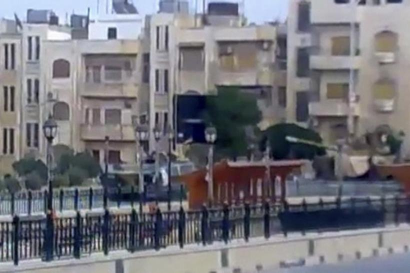 Video grab of a tank along a street in Hama