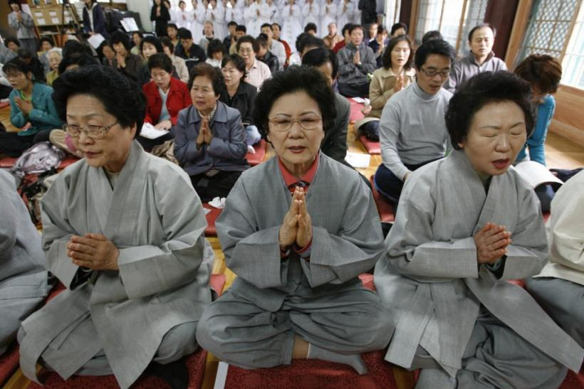 People pray in Seoul