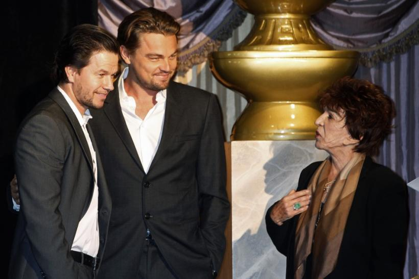 Actors Mark Wahlberg (L) and Leonardo DiCaprio (C) pose at the Hollywood Foreign Press Association's (HFPA) Annual Installation Luncheon with HFPA president Aida Takla O'Reilly in Beverly Hills, California