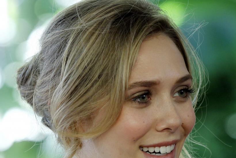 Actress Elizabeth Olsen, younger sister of Mary-Kate and Ashley Olsen, arrives for the Hollywood Foreign Press Association annual installation luncheon in Beverly Hills, California