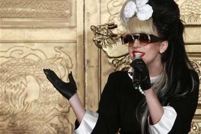 Lady Gaga speaks during a news conference in Taipei