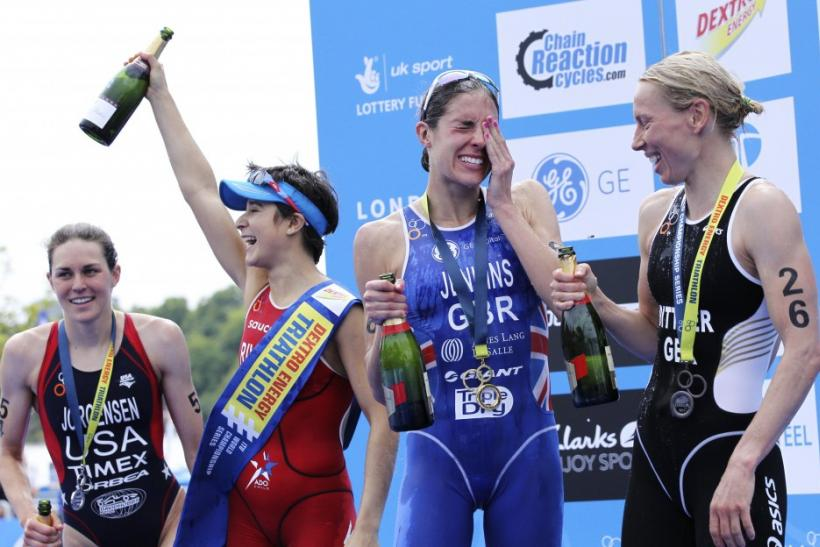 Barbara Riveros Diaz of Chile, Great Britain's Helen Jenkins and Anja Dittmer of Germany celebrate after the women's Triathlon