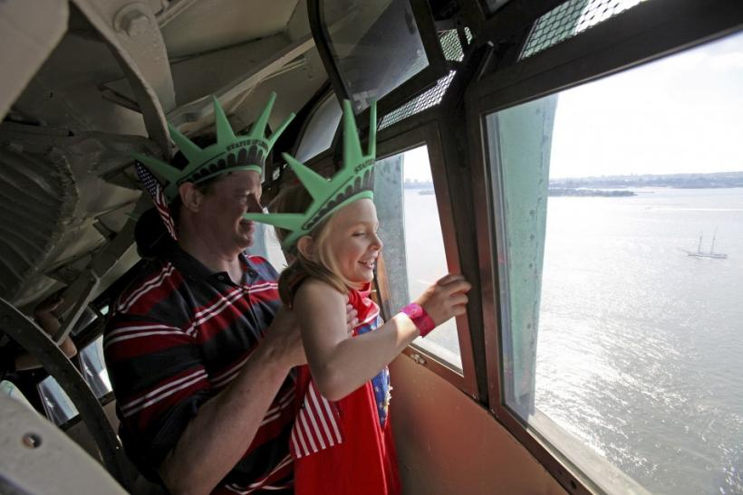 Chris Bartnick hoists his daughter Aleyna inside Statue of Liberty in New York