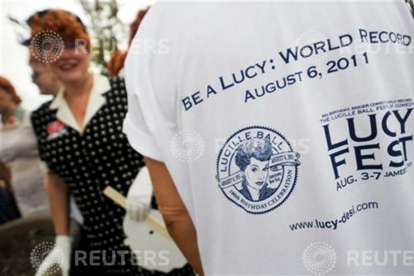 A woman dressed as Ricardo during attempt to set a new Guinness world record for the most Lucy lookalikes assembled in one place, in Jamestown