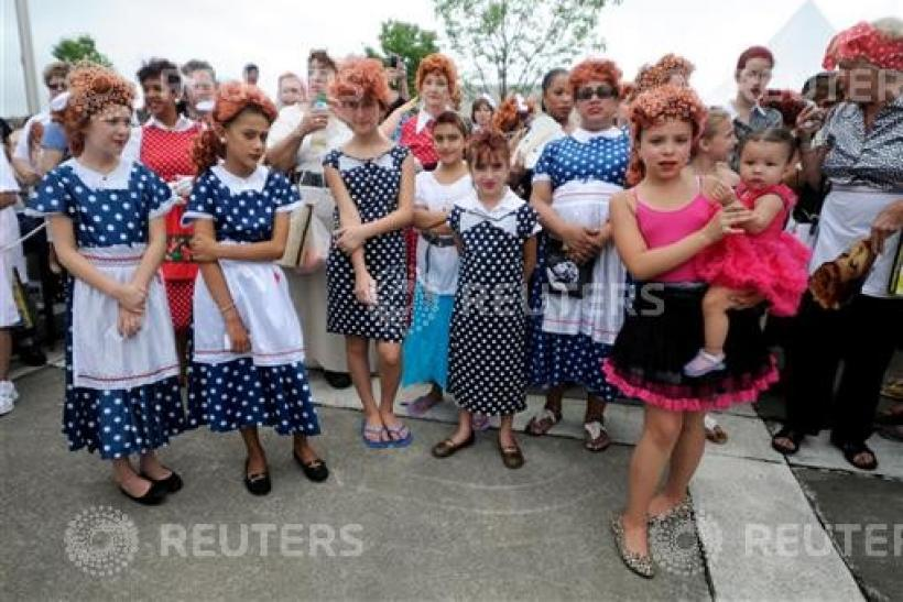 People pose during attempt to set a new Guinness world record for most Lucy Ricardo lookalikes assembled in one place, in Jamestown