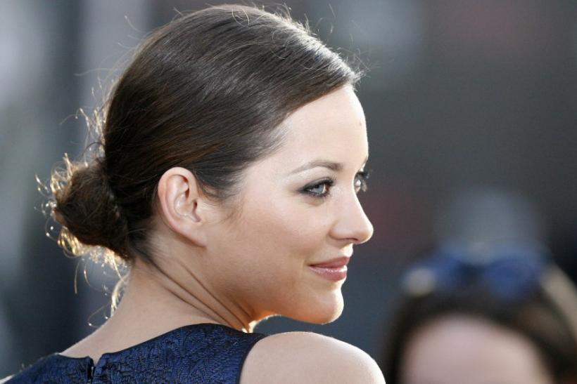 "Cotillard poses at the premiere of ""Inception"" at the Grauman's Chinese theatre in Hollywood"