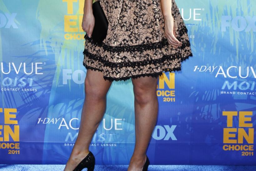 Actress Zooey Deschanel arrives at the Teen Choice Awards in Los Angeles