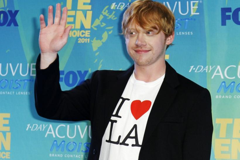 "British actor Rupert Grint poses in the press room backstage wearing an ""I Love L.A."" t-shirt at the Teen Choice Awards in Los Angeles"