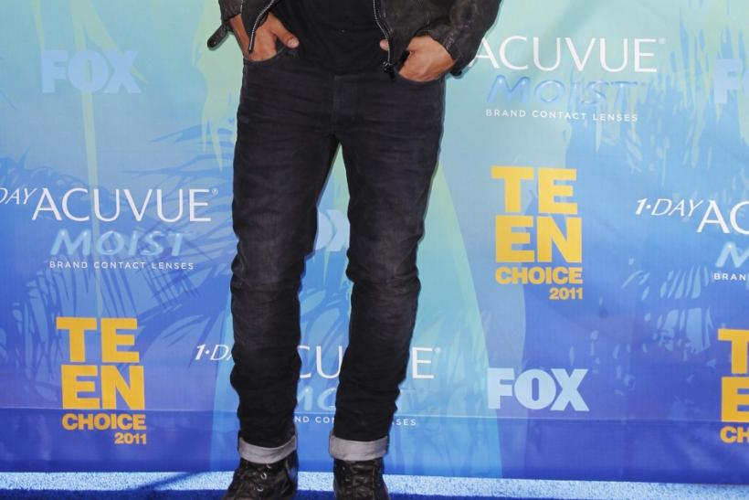 Actor Taylor Lautner arrives at the Teen Choice Awards in Los Angeles