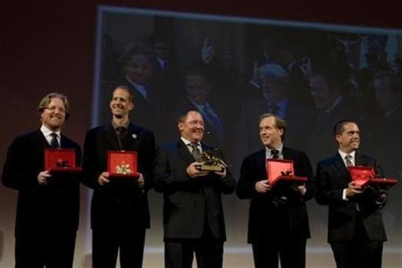 Directors of Walt Disney and Pixar Animation Studios Andrew Stanton (L), Pete Docter (2nd L), Brad Bird and Lee Unkrich (R) pose with John Lasseter (C), chief creative officer at the studios, after receiving the lifetime career awards at the 66th Venice F