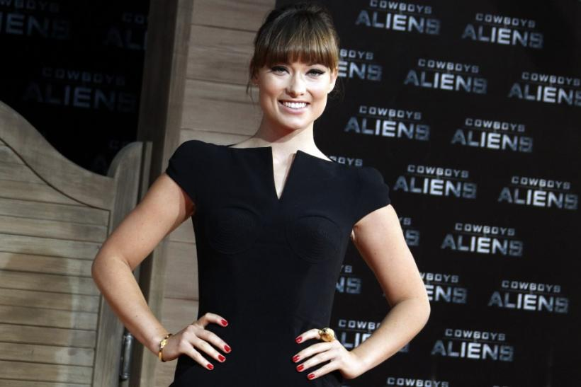 Cast member Olivia Wilde poses for pictures before the German premier of the movie 'Cowboys and Aliens' in Berlin