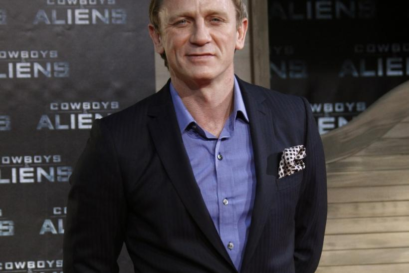 Cast member Daniel Craig poses before the German premier of the movie 'Cowboys and Aliens' in Berlin