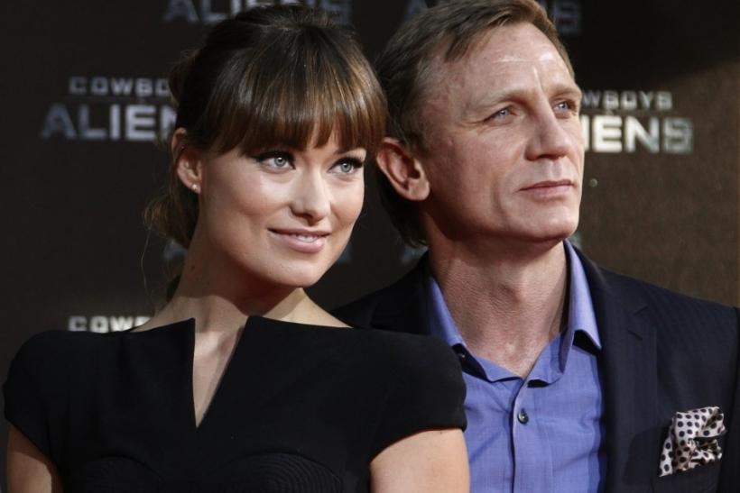 Cast members Olivia Wilde (L) and Daniel Craig pose before the German premier of the movie 'Cowboys and Aliens' in Berlin