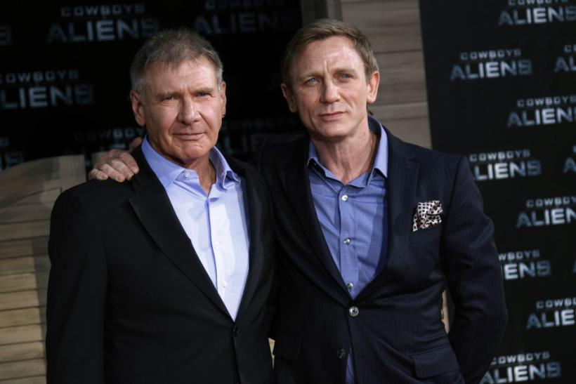 Cast members Harrison Ford (L) and Daniel Craig pose before the German premier of the movie 'Cowboys and Aliens' in Berlin